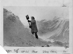 Woman shoveling, surrounded by snow by The Buffalo Courier-Express Newspaper