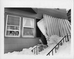 Children smiling through window next to collapsed porch by The Buffalo Courier-Express Newspaper