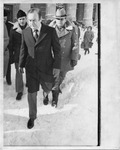 Politicians walking through snow in front of city hall by The Buffalo Courier-Express Newspaper