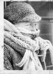 Close up of woman covered in snow with hat and scarf