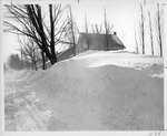 Snowbank covering first story of home by The Buffalo Courier-Express Newspaper