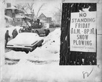 Towing service removing cars from snowy street by The Buffalo Courier-Express Newspaper
