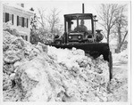 Plow removing snow