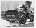 Tractor converted to snowplow by The Buffalo Courier-Express Newspaper
