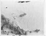 Aerial view of one home covered by snow