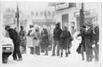 14 people standing near the bus stop in the snow by The Buffalo Courier-Express Newspaper