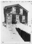 Snow covered brick house by The Buffalo Courier-Express Newspaper