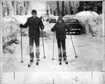 Two kids skiing down the street by The Buffalo Courier-Express Newspaper