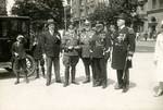 Officers standing near a vehicle by The Francis Fronczak Collection