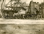 Military men in front of a building