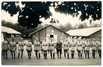 Officers in front of barracks