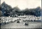 Field Mass, kneeling.