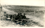 Soldiers in a trench with arns
