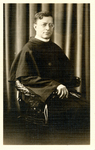 A priest, seated by The Francis Fronczak Collection