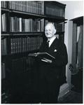 Francis Eustachius Fronczak holding an open book by The Francis Fronczak Collection