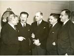 Francis Eustachius Fronczak in a discussion with four men. by The Francis Fronczak Collection