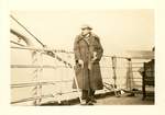 Jozef Haller standing on the deck of a ship. by The Francis Fronczak Collection