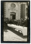 Guests standing in the courtyard near a set table by The Francis Fronczak Collection