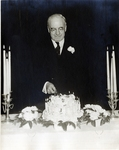 Dr. Harry W. Rockwell with Cake Photograph; c. 1940-1950 by Harry W. Rockwell