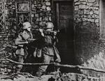 German Soldiers Breaking Down the Door of a Polish House