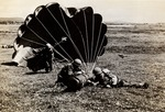 Exercises: 3 Soldiers with Parachute After Landing