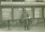 Stanley M. Wiśniewski In Front of a U.S. Military Government Bulletin Board at Dachau, Germany